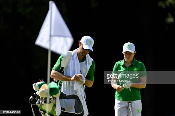 Saitama , Japan - 4 August 2021; Stephanie Meadow of Ireland with her caddie Kyle Kallan on the 15th green during round one of the women's individual...