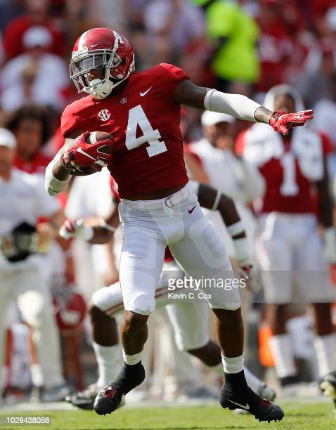 Saivion Smith of the Alabama Crimson Tide intercepts a pass by Justice Hansen of the Arkansas State Red Wolves and returns it for a touchdown at...