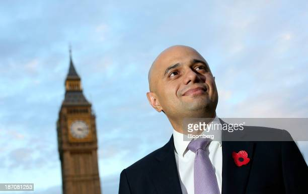 Sajid Javid financial secretary to the UK treasury poses for a photograph near the Houses of Parliament following an interview in London UK on...