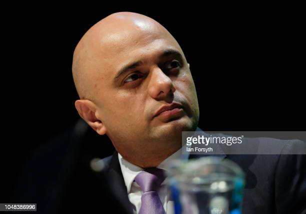 Sajid Javid Secretary of State for the Home Department speaks with Katharine Viner Editor of Chief of the Guardian in an evening fringe event on day...