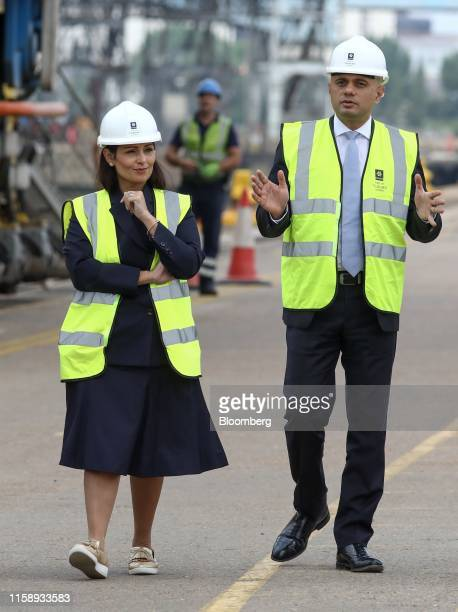 Sajid Javid UK chancellor of the exchequer right and Priti Patel UK home secretary visit Tilbury Docks to announce details of further funding for...