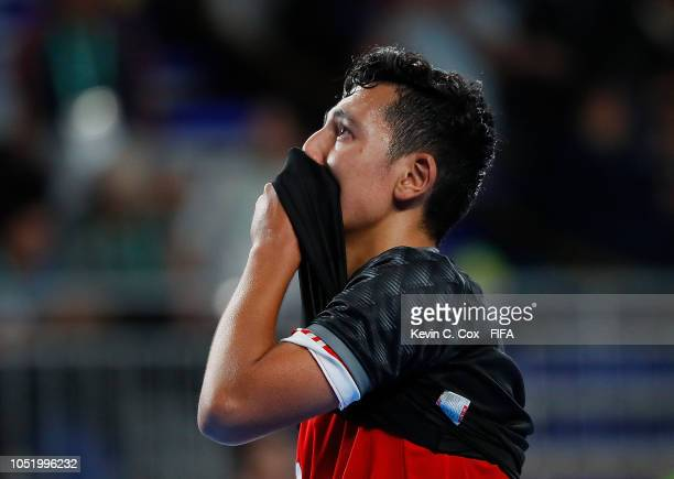 Sajjad Adelipour of IR Iran reacts after their 21 loss to Russia in the Men's Futsal Group B match between IR Iran and Russia during the Buenos Aires...