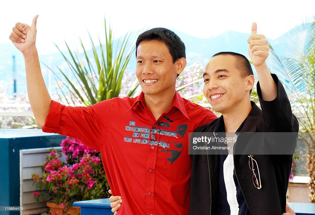 Sakada Kaewbuadee and Apichatpong Weerasethakul during 2004 Cannes Film Festival - 'Tropical Malady' - Photocall at Palais Du Festival in Cannes, France.