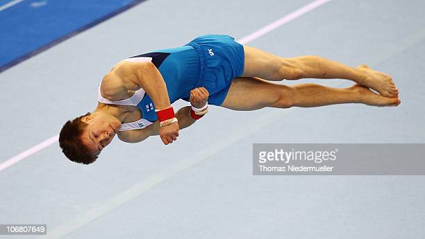 Sakari Vekki of Finnland performs at the floor during the EnBW Gymnastics Worldcup 2010 at the Porsche Arena on November 13 2010 in Stuttgart Germany