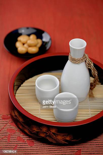 sake and japanese rice crackers - saki stock photos and pictures