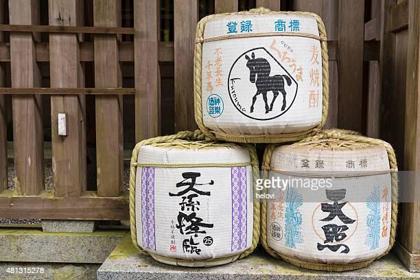 sake barrels at shinto shrine - saki stock photos and pictures