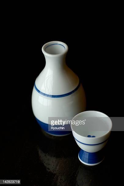 sake bottle and sake cup - saki stock photos and pictures