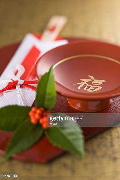 Sake cup and chopsticks on tray