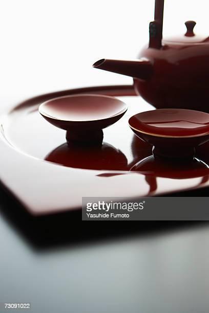 Sake pot and cups, close-up