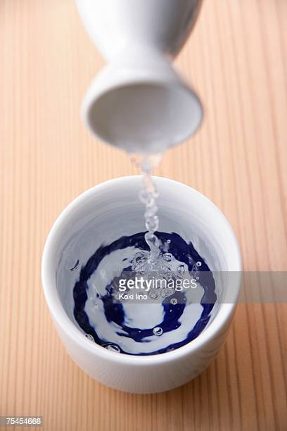 Sake pouring into cup