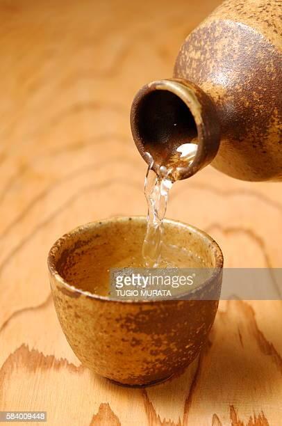 Sake pouring into Sake cup, close up