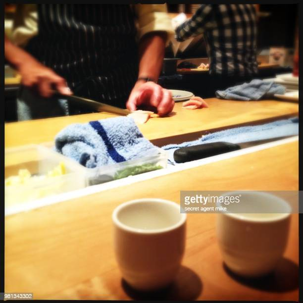 sake shots at restaurant - sushi restaurant stock photos and pictures