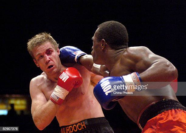 Sakeasi Dakua of Fiji punches Paul Murdoch of Australia during the World Boxing Association Intercontinental Championship Light Heavyweight fight on...