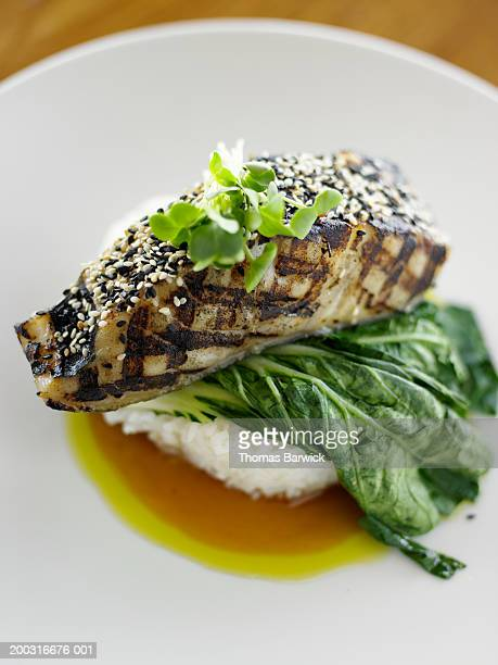 Sake-glazed sablefish over jasmine rice, honey soy and scallion oil