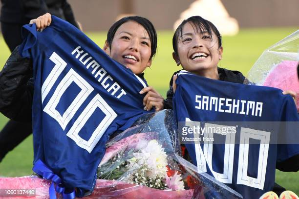 Saki Kumagai and Aya Sameshima of Japan pose for photographs with a shirt to mark their 100th appearance for the national team along after the...