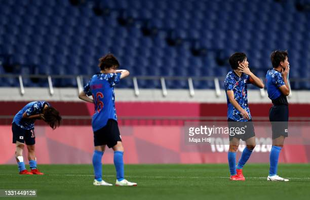 Saki Kumagai and Moeka Minami of Team Japan look dejected following defeat in the Women's Quarter Final match between Sweden and Japan on day seven...