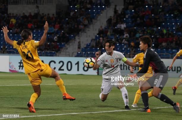 Saki Kumagai and Saki Kumagai of Japan in action against Samantha May Kerr of Australia during 2018 AFC Women's Asian Cup Final match between Japan...