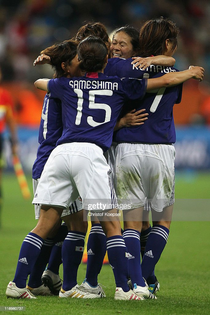 Saki Kumagai, Aya Sameshima, Homare Sawa and Kozue Ando of Japan celebrate winning 3-1 the FIFA Women's World Cup Semi Final match between Japan and Sweden at the FIFA World Cup stadium Frankfurt on July 13, 2011 in Frankfurt am Main, Germany.