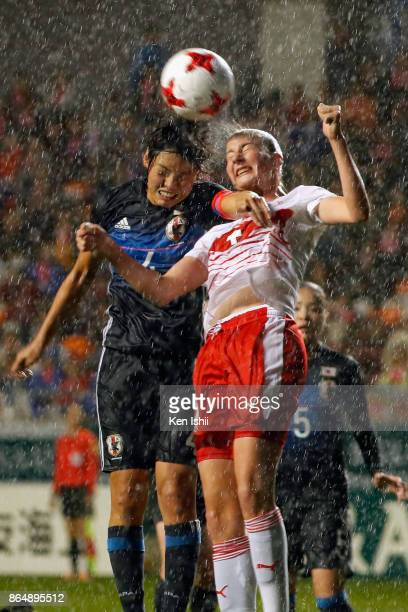 Saki Kumagai of Japan and Lia Walti of Switzerland compete for the ball during the international friendly match between Japan and Switzerland at...