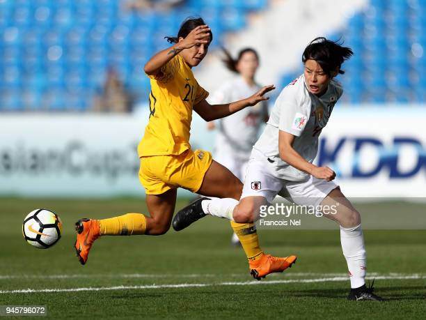 Saki Kumagai of Japan and Samantha May Kerr of Australia in action during the AFC Women's Asian Cup Group B match between Japan and Australia at the...