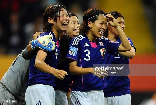 Saki Kumagai of Japan celebrates with Azusa Iwashimizu and other team mates after winning the FIFA Women's World Cup Semi Final match between Japan...