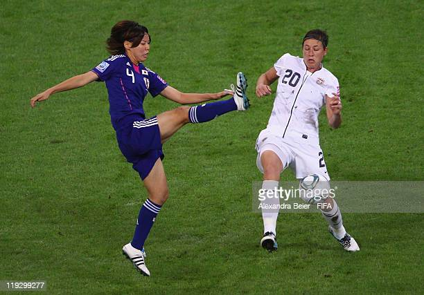 Saki Kumagai of Japan fights for the ball with Abby Wambach of USA during the FIFA Women's World Cup Final match between Japan and USA at the FIFA...