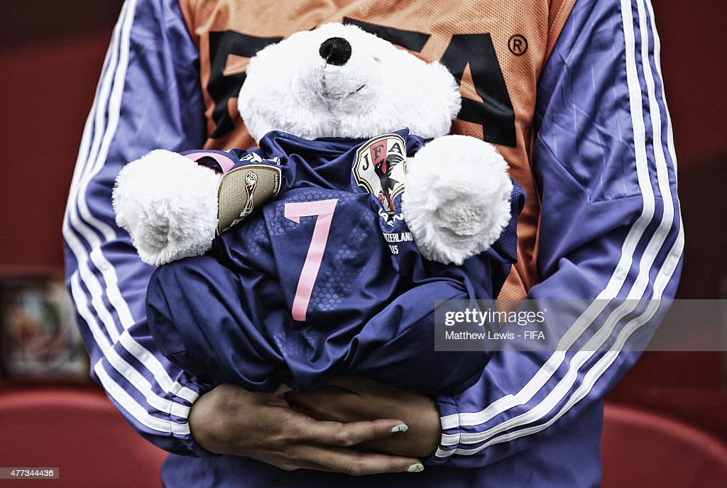 Saki Kumagai of Japan holds a bear wearing a shirt in honour of Kozue Ando, after she broke her leg in an earlier match ahead of the FIFA Women's World Cup 2015 Group C match between Ecuador and Japan at Winnipeg Stadium on June 16, 2015 in Winnipeg, Canada.
