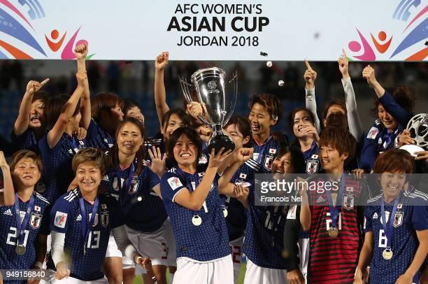 Saki Kumagai of Japan lifts the trophy after the AFC Women's Asian Cup final between Japan and Australia at the Amman International Stadium on April...