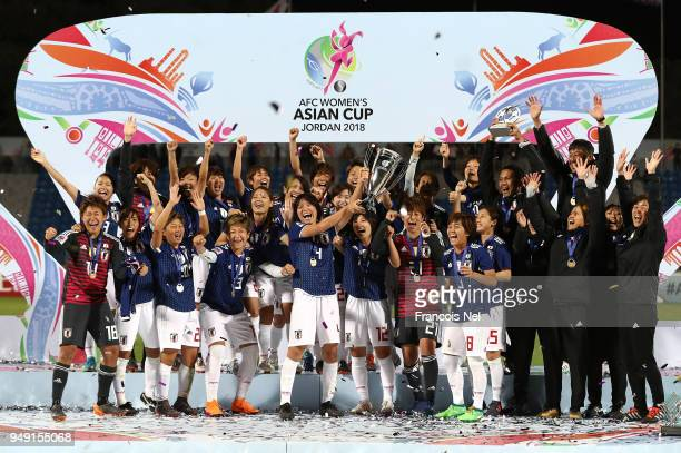 Saki Kumagai of Japan lifts the trophy after winning the AFC Women's Asian Cup final between Japan and Australia at the Amman International Stadium...