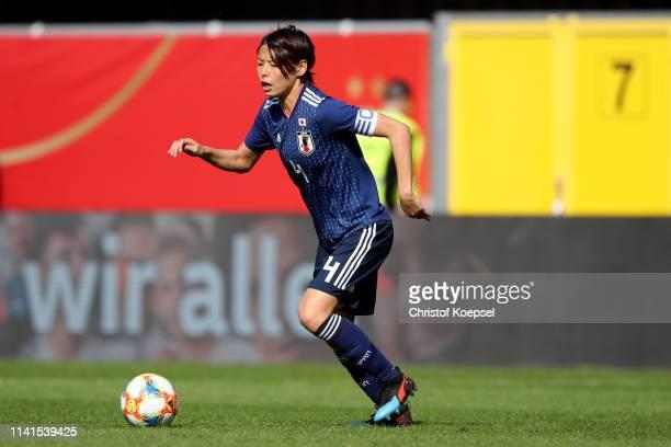 Saki Kumagai of Japan runs with the ball during the Women's International Friendly match between Germany and Japan at Benteler Arena on April 09 2019...