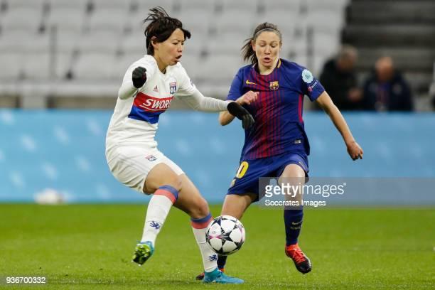 Saki Kumagai of Olympique Lyon Women Elise Bussaglia of FC Barcelona Women during the match between Olympique Lyon Women v FC Barcelona Women at the...