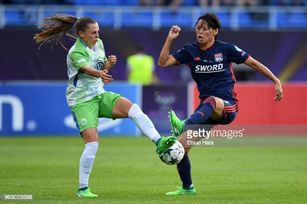 Saki Kumagai of Olympique Lyonnais and Noelle Maritz of Wolfsburg compete for the ball during the UEFA Womens Champions League Final between VfL...