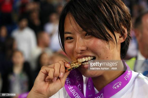 Saki Kumagai of Olympique Lyonnais kisses her winners medal after the UEFA Women's Champions League Final between Lyon and Paris Saint Germain on...