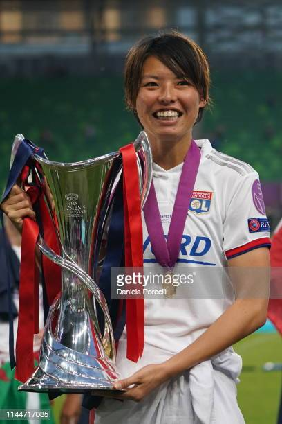 Saki Kumagai of Olympique Lyonnais the trophy after their victory of the Champions League after the UEFA Women's Champions League Final between...