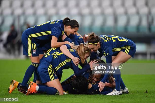 Saki Kumagai of Olympique Lyonnais Women celebrates a goal with team mates during the UEFA Women's Champions League round of 32 first leg match...