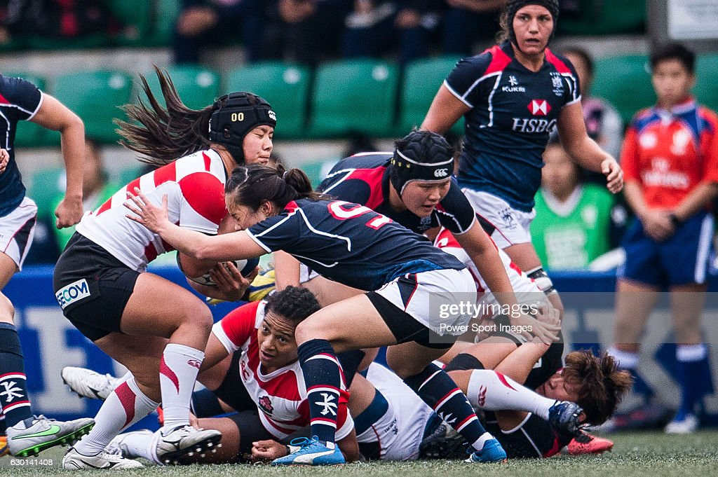Saki Minami of Japan (l) competes against Hong Kong during the Womens Rugby World Cup 2017 Qualifier match between Hong Kong and Japan on December 17, 2016 in Hong Kong, Hong Kong.