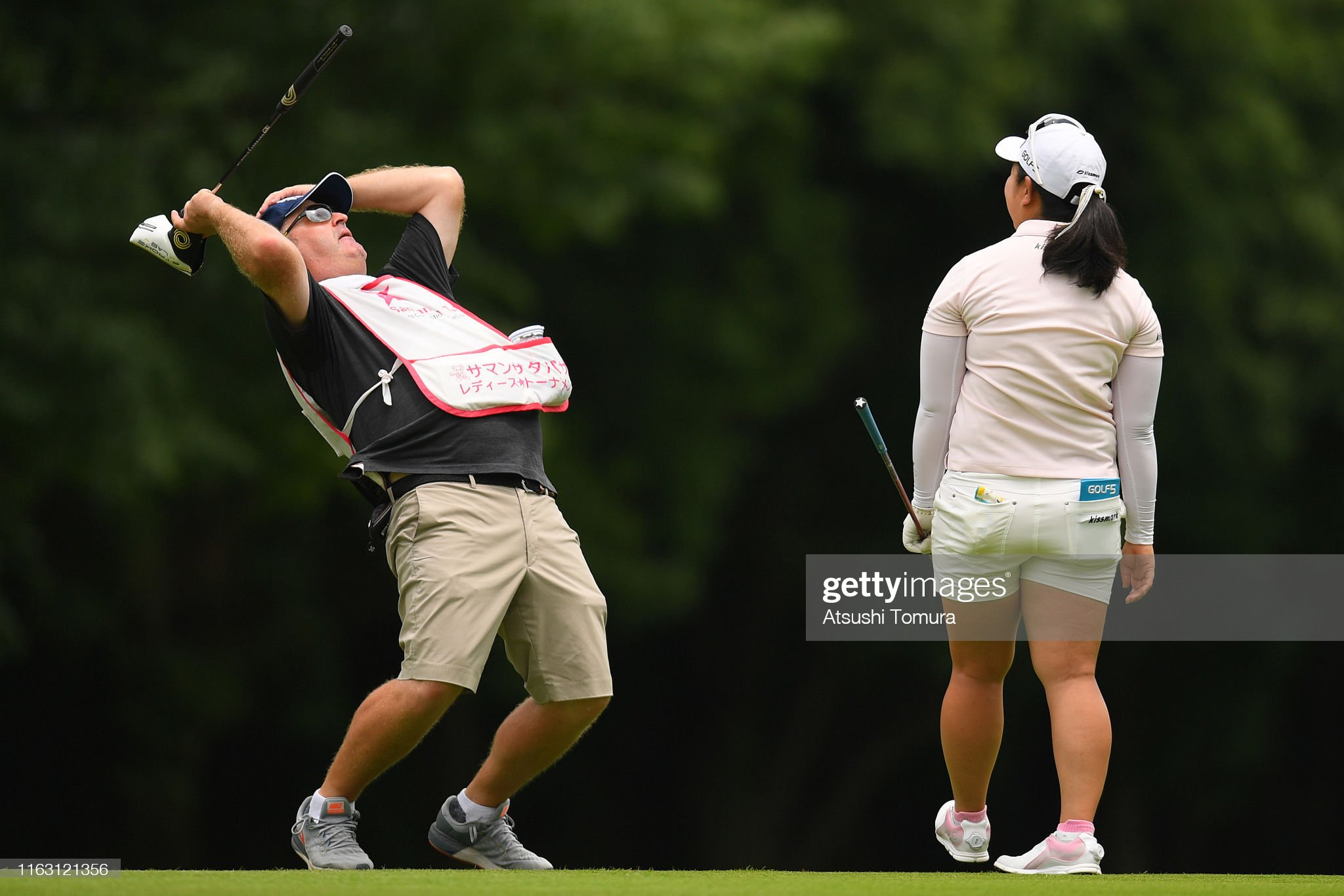 https://media.gettyimages.com/photos/saki-takeo-of-japan-and-her-caddie-react-after-her-second-shot-on-the-picture-id1163121356?s=2048x2048