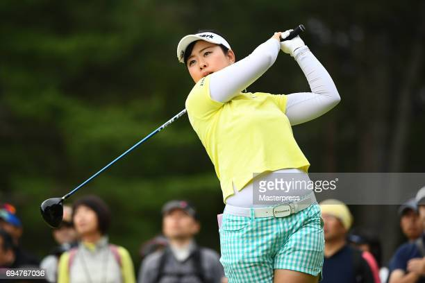 Saki Takeo of Japan hits her tee shot on the 5th hole during the final round of the Suntory Ladies Open at the Rokko Kokusai Golf Club on June 11...