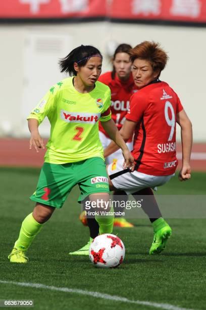 Saki Ueno of JEF United Chiba Ladies and Yuika Sugasawa of Urawa Red Diamonds Ladies compete for the ball during the Nadeshiko League match between...