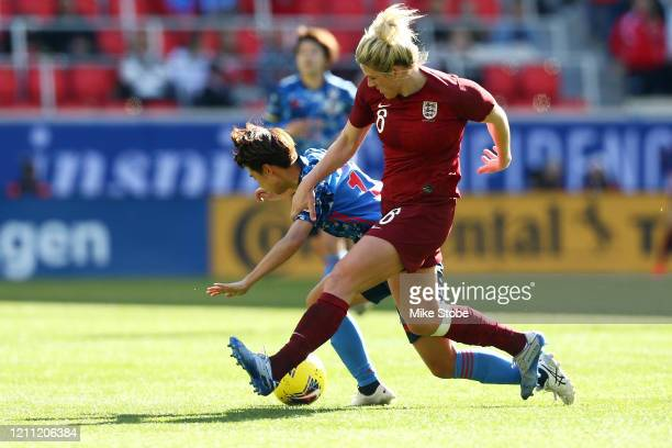 Sakiko Ikeda of Japan and Millie Bright of England vie for the ball at Red Bull Arena on March 08 2020 in Harrison New Jersey