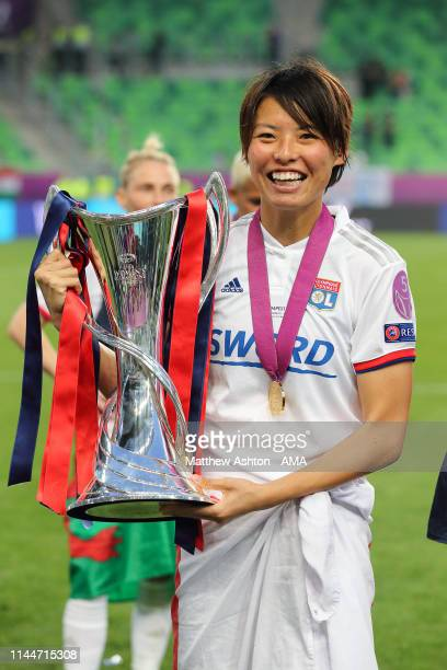 SakiKumagai of Olympique Lyonnais celebrates with the trophy after the UEFA Women's Champions League Final between Olympique Lyonnais v FC Barcelona...