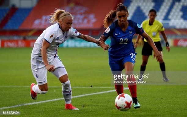 Sakina Karchaoui of France and Gunnhildur Jónsdóttir of Iceland compete for the ball during the Group C match between France and Iceland during the...