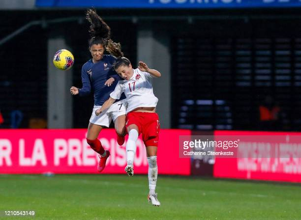 Sakina Karchaoui of France and Jessie Fleming of Canada go up for a head ball during the Tournoi de France match between France and Canada at Stade...