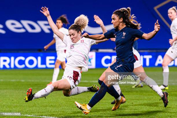 Sakina Karchaoui of France attempts a kick while being defended by Luana Buhler of Switzerland during the friendly match between France and...