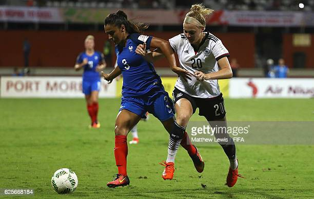 Sakina Karchaoui of France holds off Laura Freigang of Germany during the FIFA U20 Women's World Cup Papua New Guinea 2016 Quarter Final match...