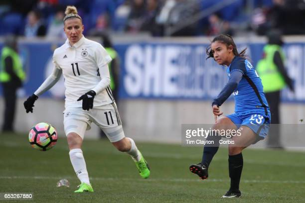 Sakina Karchaoui of France in action watched by Anja Mittag of Germany during the France Vs Germany SheBelieves Cup International match at Red Bull...