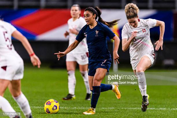 Sakina Karchaoui of France is chased by Luana Buhler of Switzerland during the friendly match between France and Switzerland at Saint-Symphorien...