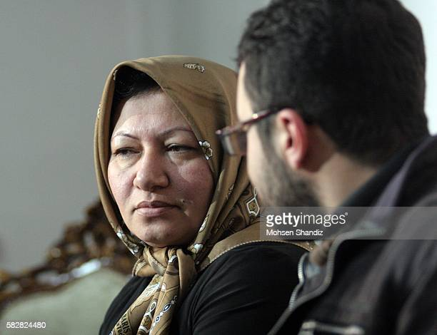 Sakineh Mohammadi Ashtiani an Iranian 43 years old woman sentenced to death by stoning for adultery takes a seat next to her son Sajjad Qaderzadeh...