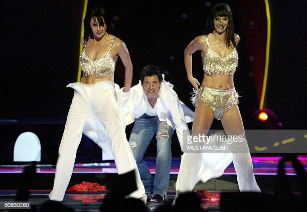 Sakis Rouvas of Greece performs during the semifinals for the 49th Eurovision Song Contest at Abdi Ipekci Sport Salon in Istanbul 12 May 2004 AFP...