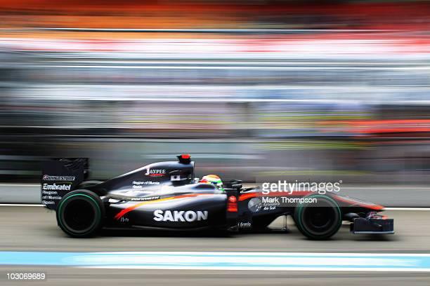 Sakon Yamamoto of Japan and Hispania Racing Team drives down the pitlane during qualifying for the German Grand Prix at Hockenheimring on July 24...